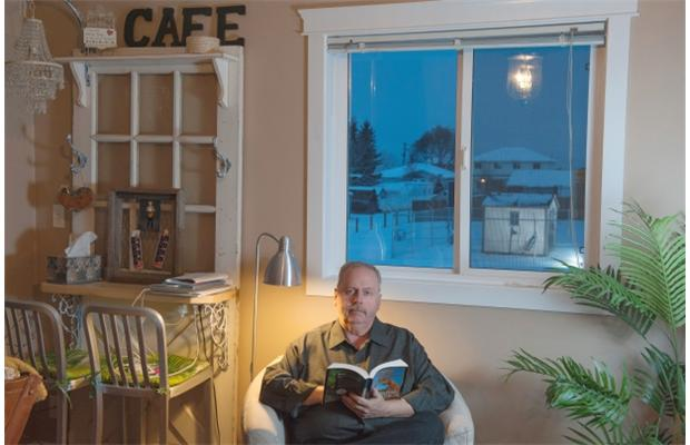 2014 12 11 Ralph Olson in his home, Leaking Imperial Oil well outside window