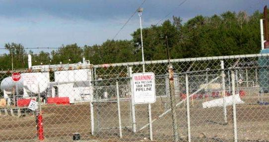 2014 close up Bonavista South Rosevear Gas Plant. warning sign, high pressure sour water pipeline, 16-11-54-15 W5M, near Edson, Alberta