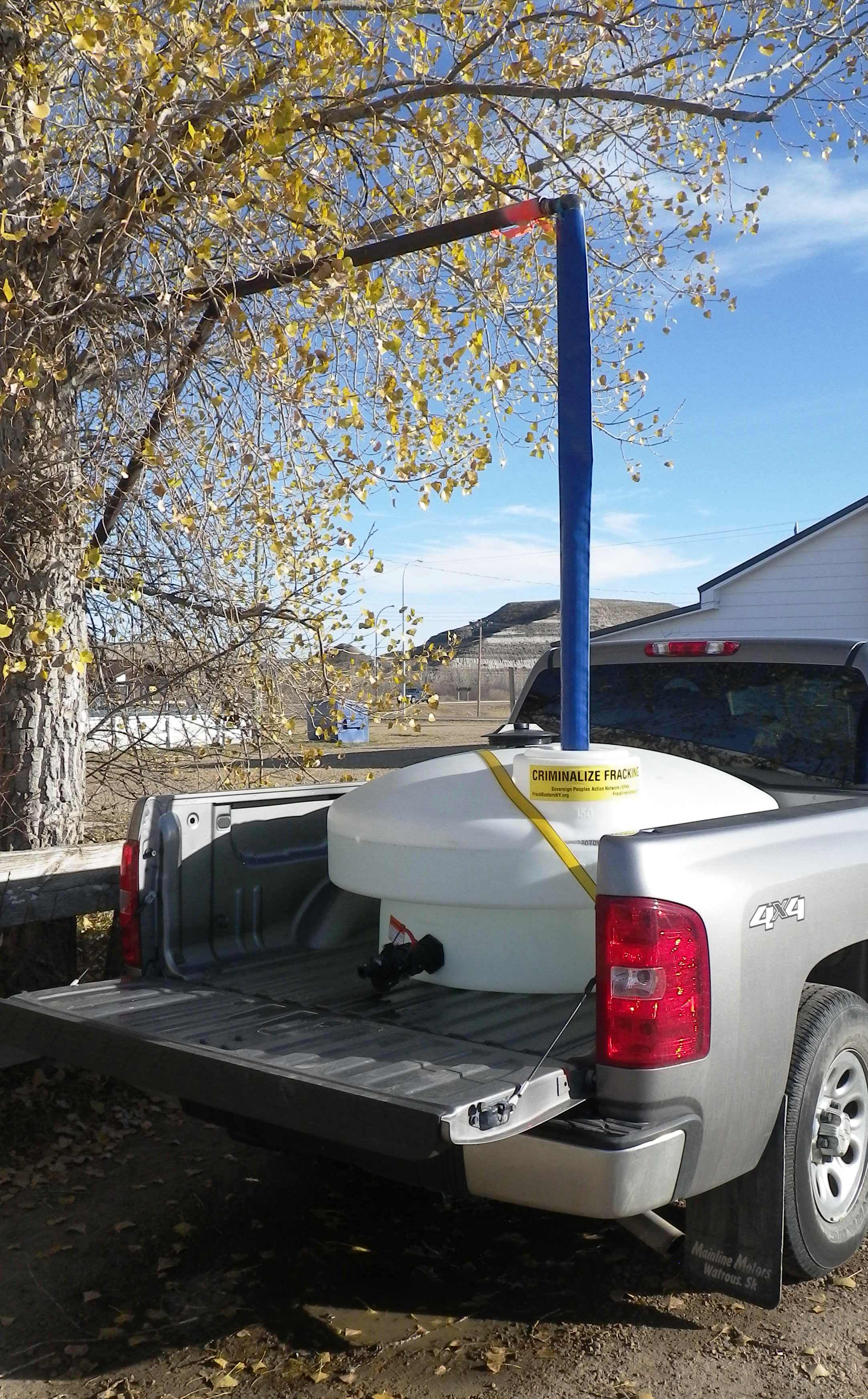2015 10 21 Ernst hauling water from Rosedale, 45 minutes one way drive from Rosebud, NY criminalize fracing sticker on tank