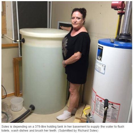 2016 07 26 Carol Soles w 378 litre water tank, CBC News Husky bitimen, chemical spill N Sk river