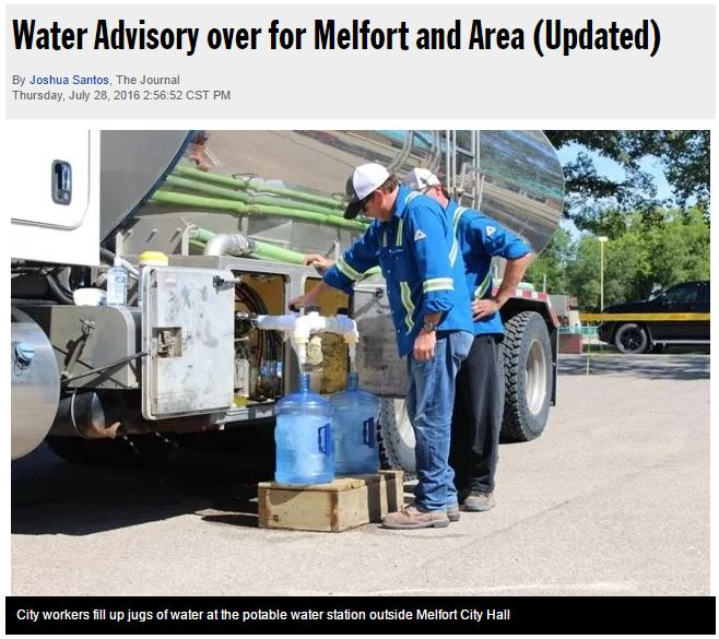 2016 07 28 Melfort workers fill water jugs, re Husky bitumen and chemical additive spill